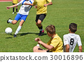 Young soccer players 30016896