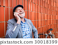 Senior man with smartphone and bicycle against 30018399