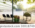 outdoor tennis court view through metal net 30018749