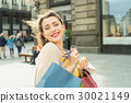 Stylish woman with shopping bags. 30021149