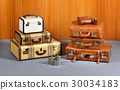 Stacks of Antique Suitcases and Drinking Flasks 30034183