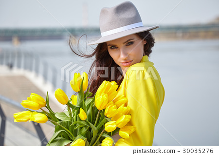 Smiling woman with bunch of flowers 30035276