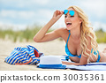 Outdoor fashion portrait of glamour lady enjoying her vacation 30035361