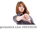 angry businesswoman giving, showing thumb down 30035630