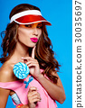 Bright makeup. Beauty Girl Portrait holding Colorful lollipop. B 30035697