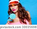 Bright makeup. Beauty Girl Portrait holding Colorful lollipop. B 30035698