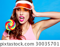 Bright makeup. Beauty Girl Portrait holding Colorful lollipop. B 30035701