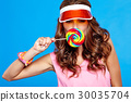 Bright makeup. Beauty Girl Portrait holding Colorful lollipop. B 30035704