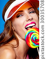 Bright makeup. Beauty Girl Portrait holding Colorful lollipop. B 30035708