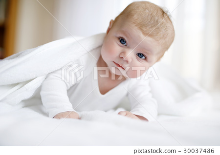 Baby girl wearing white towel or winter overal in 30037486
