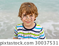 Little kid boy having fun on tropical beach 30037531