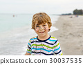 Little kid boy having fun on tropical beach 30037535