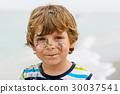 Little kid boy having fun on tropical beach 30037541