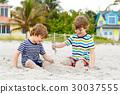 Two little kids boys having fun on tropical beach 30037555