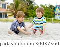 Two little kids boys having fun on tropical beach 30037560