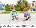 Two little kids boys having fun on tropical beach 30037563