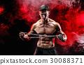 Portrait of muscular sportsman tearing metal chain 30088371