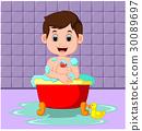 Boy sitting in a bathtub filled with bubbles  30089697