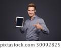 Happy man using digital tablet 30092825