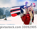 Winter smiling woman with snowboard 30092905