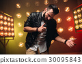 Bearded performer with microphone sing a song 30095843