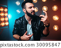 Bearded performer with microphone sing a song 30095847