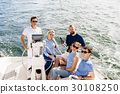 Group of happy friends having a party on a yacht 30108250