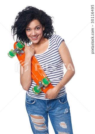 Happy female in distressed jeans with skateboard 30116495