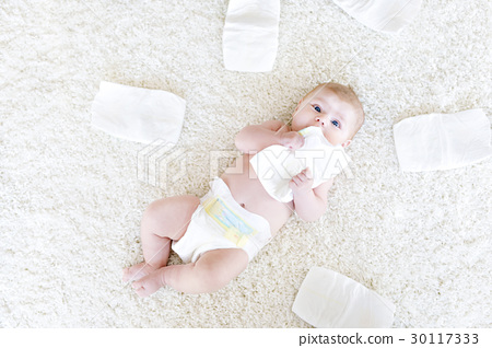 newborn baby girl with diapers. Dry skin and 30117333