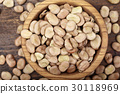 Dried broad beans in a wooden bowl 30118969