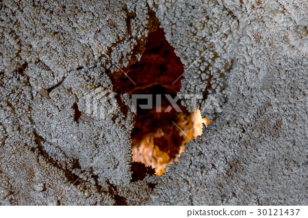 Large hole in the wall of a cave 30121437