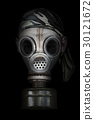 Old gas mask on a black background 30121672