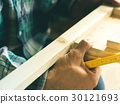 Man crafting wooden object. Lifestyle process 30121693