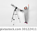 Happy child girl dressed in an astronaut costume 30122411