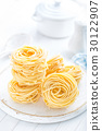 Raw pasta on white background closeup 30122907