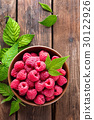 Fresh raspberry with leaves on wooden background 30122926