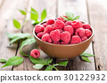Fresh raspberry with leaves on wooden background 30122932