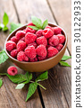 Fresh raspberry with leaves on wooden background 30122933
