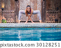 Asia woman doing yoga beside swimming pool 30128251