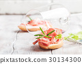 red wine and bruschetta with prosciutto  30134300