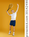 young tennis player plays tennis on yellow 30142490