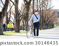 Senior man in blue checked shirt with bicycle in 30146435
