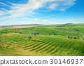 Hilly terrain with a terrace and a blue sky 30146937