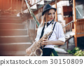 Young girl with saxophone - outdoor in old town 30150809