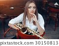 Young girl with saxophone outdoor 30150813