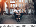 Young girl with saxophone sitting sits earth 30150960