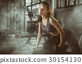 Young attractive sporty woman with dumbbells 30154130
