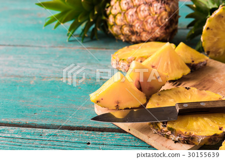 pineapple on the wood texture background.. 30155639
