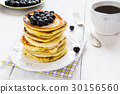 Stack of homemade pancakes with black currant 30156560