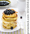 Stack of homemade pancakes with black currant 30156561